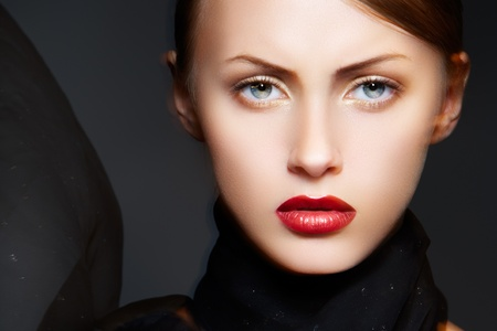 Fashion woman with luxury make-up, sexy lips and black scarf Stock Photo - 9305232