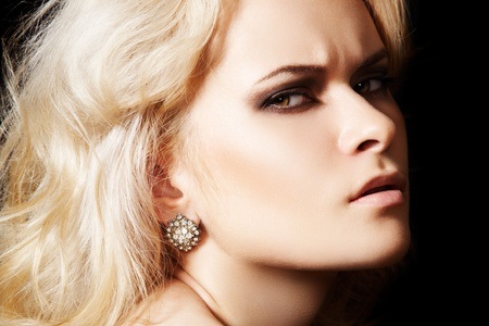 Chic fashion frown model with diamond jewelry, blond hair photo
