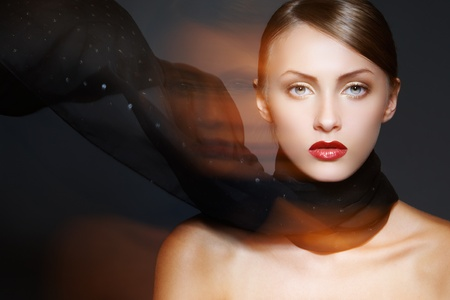 Beautiful model with luxury make-up, sexy lips and fashion scarf Stock Photo - 9305225