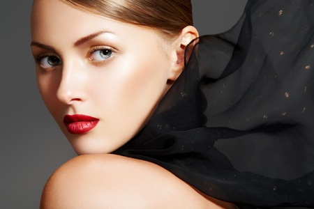 Sensual woman with luxury make-up, sexy lips and black scarf photo