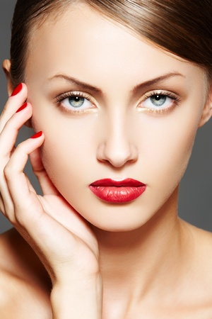 Luxury woman with make-up, juicy red lips, manicure, hairstyle photo
