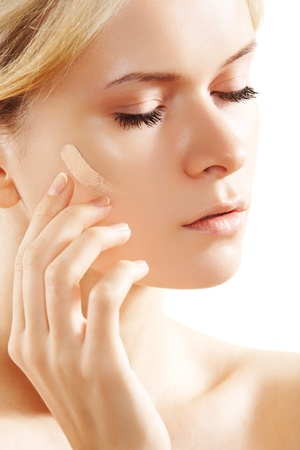 Skin care and cosmetics. Woman applying skin tone foundation Stock Photo