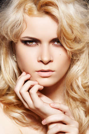 Fashion woman with chic make-up & long blond hair photo