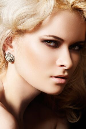 Luxury and fashion style. Female face with make-up photo