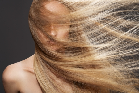 Wellness and spa. Sensual woman model with windswept flying dark blond hair on gray background. Shiny long health hairstyle. Beauty and haircare Stock Photo - 11715729