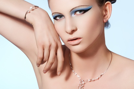 Chic beautiful woman model with luxury brilliant jewelry. Shiny diamond on white gold necklace and bracelet  photo
