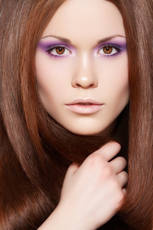 Wellness & cosmetics. Portrait of beautiful brunette woman model with healthy and shiny long straight brown hair, fashion bright neon violet make-up  Stock Photo - 11714198