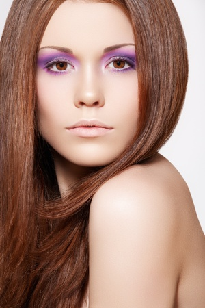 Well-being & spa. Beautiful model with shiny and healthy brown hair, straight hairstyle. Clean soft skin, bright summer violet make-up  photo