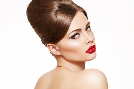 Beautiful portrait of sensual european young woman model with glamour red lips make-up, eye arrow makeup, purity skin. Retro beauty style