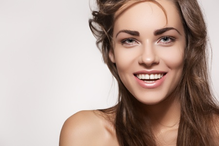 Happy beautiful young woman model with natural daily makeup. Lovely female smile with healthy white teeth  Stock Photo