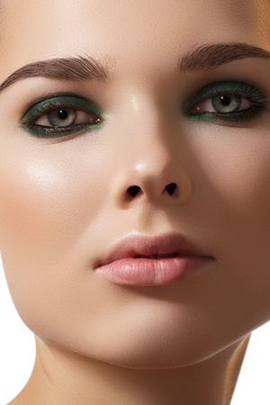 Close-up portrait of beautiful woman's purity face with dark green smoky-eyes make-up, pale full lips. Sexy model with clean shiny skin, purity complexion  photo