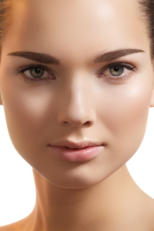Natural beauty close-up portrait of beautiful young woman model face with clean skin. Wellness, skincare and naturally make-up  photo