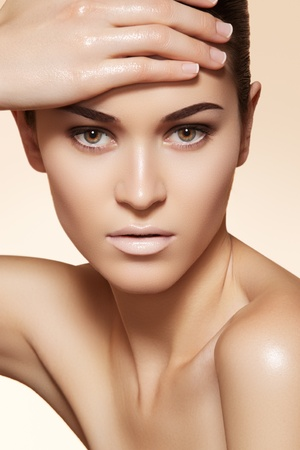 Portrait of sexy caucasian young woman. Natural spa beauty with pure skin. Beautiful model with natural make-up, clean skin on beige background  photo