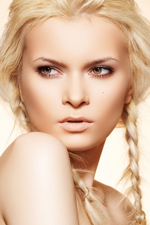 Attractive blond woman model with fashion hairstyle with braids. Hippie style  photo