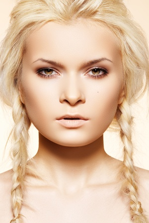 Beautiful blond woman with fashion hairstyle with pigtail