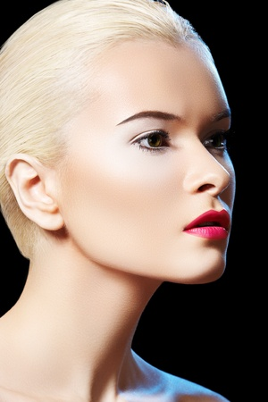 Fashion portrait of glamour woman model with bright evening lips make-up, purity complexion, slicked back hairstyle. Sensual night style