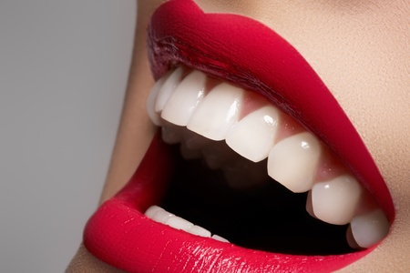 Close-up happy female smile with healthy white teeth, bright magenta lips make-up. Cosmetology, dentistry and beauty care. Macro of woman's smiling mouth Stock Photo - 11713907