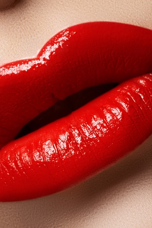 Close-up of womans lips with bright fashion red makeup. Macro bloody lipstick make-up  photo