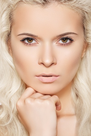 Alluring model face with naturel daily spa make-up and long blond hair. Purity skin, shiny hair  photo