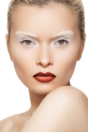slicked: High fashion image. Fashionable style of beautiful model with creative white eyebrows make-up and dark red makeup on lips
