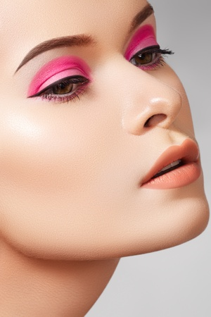 Cosmetics, skincare and visage. Close-up portrait of sexy european young woman model with glamour eye makeup with arrows, natural lips make-up, soft purity complexion. Perfect clean shiny skin  photo
