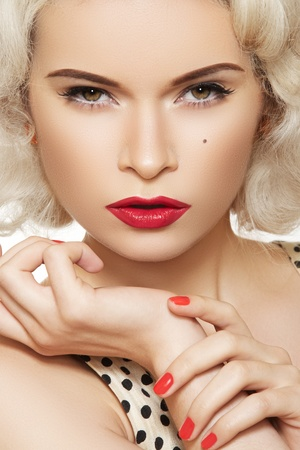 Portrait of beautiful young sexy woman with vintage make-up and hairstyle. Pin-up girl. American style  photo