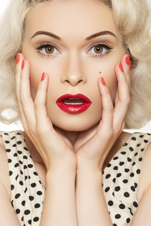Surprise! Portrait of beautiful young sexy woman with vintage make-up and hairstyle. Pin-up girl. American style