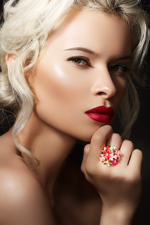 Wellness, cosmetics and romantic retro style. Close-up portrait of sensuality beautiful blond woman model face with fashion make-up, sexy evening lips makeup. Luxury accessories, big ring with flowers Stock Photo - 11713200
