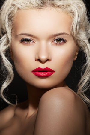 Wellness, cosmetics and romantic retro style. Close-up portrait of sensuality beautiful blond woman model face with fashion make-up, sexy evening lips makeup. Luxury accessories, big ring with flowers Stock Photo - 11713199