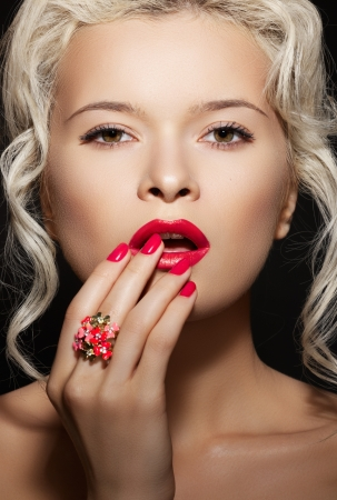 Cosmetics, accessories and romantic retro style. Sexy beautiful blonde female model with fashion make-up, sexy evening red lips makeup, bright nails with polish manicure and big cocktail ring  photo