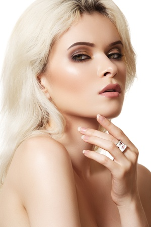 Beautiful blond woman model with brown smoky-eye make-up and white ring  photo