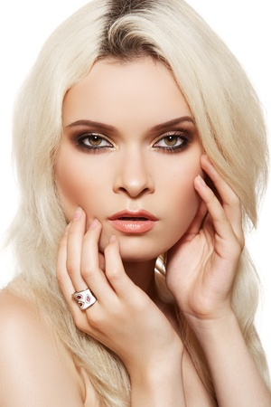 Beautiful blond woman model with brown smoky-eye make-up and white ring on white background. Elegance style  photo