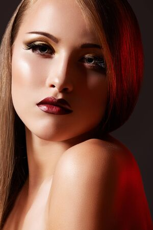 Chic evening style. Alluring woman model with luxury fashion make-up, dark red lips makeup and long hair  photo