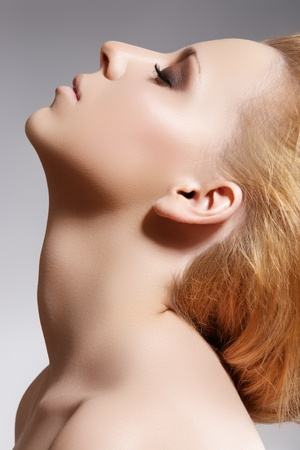 woman neck: Young woman model face close-up with closed eyes. Relaxation concept. Neck care, spa, cosmetics and make-up