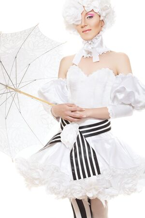 Cute woman in white and black carnival costume with flowers had and lacy umbrella. Cosplay style  photo