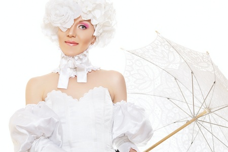 wedding portrait: Cute woman in white carnival costume with flowers had and lacy umbrella. Creative retro wedding style