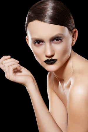 slicked: Woman model with fashion slicked hairstyle, make-up & black lips