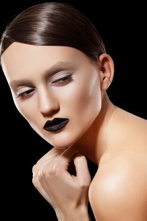 slicked back hair: Woman model with fashion slicked hairstyle, make-up & black lips