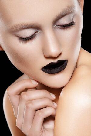 Beautiful fashion model with black lips make-up, perfect skin  Stock Photo - 11572803