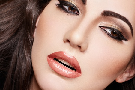 make up face: Oriental style. Sensual arabic woman model. Beautiful clean skin, saturated makeup. Bright eye make-up and dark eyeliner