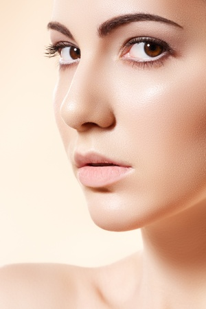 Spa, skincare, wellness & health. Close-up portrait of beautiful female model face with purity health skin & light make-up on bright beige background Stock Photo - 11572486