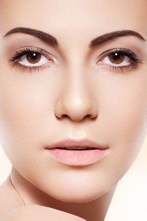 Spa, skincare, wellness & health. Front close-up portrait of beautiful female model face with purity health skin & light make-up on bright beige background  Stock Photo - 11572495