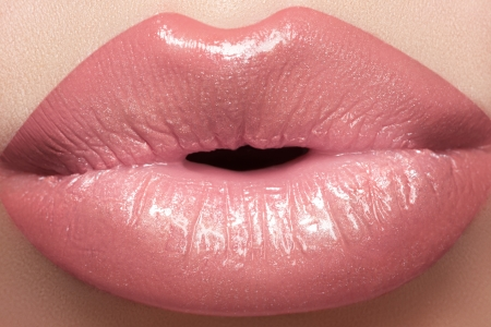 Gentle kiss. Beautiful fashion lip make-up. Macro of female lips with natural light makeup  photo