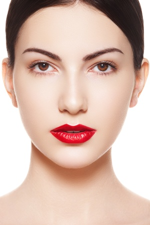 bright lipstick: Close-up portrait of sexy caucasian young model with glamour red lips make-up. Perfect clean skin. Spanish woman purity face with bright lips make-up