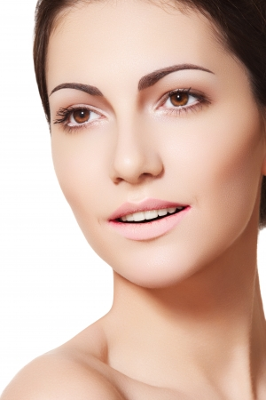 Happy female model face with healthy clean skin. Beauty, wellness, healthcare, skin care. Soft clean female model face with natural make-up, shiny complexion. Clean daily look
