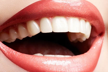 Close-up happy female smile with healthy white teeth, bright gloss lips make-up. Cosmetology, dental and beauty care  Stock Photo - 11572493