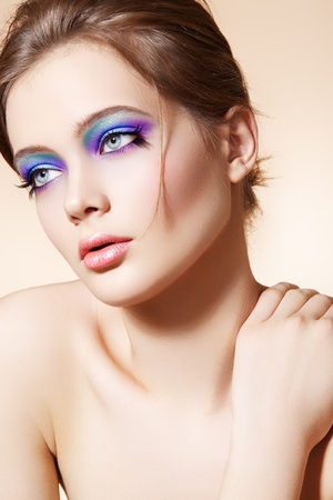 Beautiful woman model with bright fashion make-up, simple hairstyle Stock Photo - 11540687