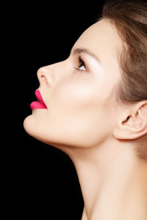 Close-up side view of beauty with clean skin & bright make-up. Chic fashion woman model