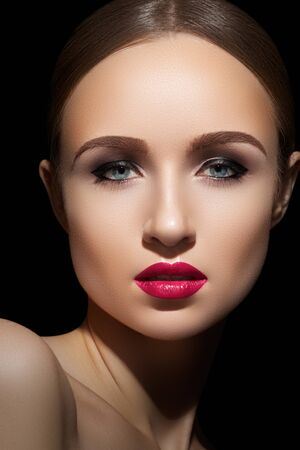 Sexy woman model with bright fuchsia lips makeup, strong eyebrows   cheekbones and healthy shiny skin  Evening glamour style, fashion make-up  photo