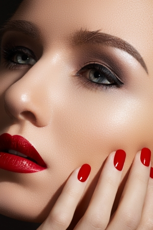 Beautiful close-up portrait of fashion woman model with glamour classic makeup, red lipstick, bright nail polish  Evening style, retro visage and manicure  photo